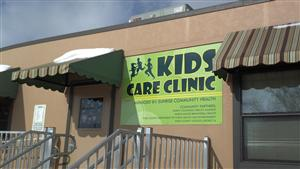 kids care clinic sign