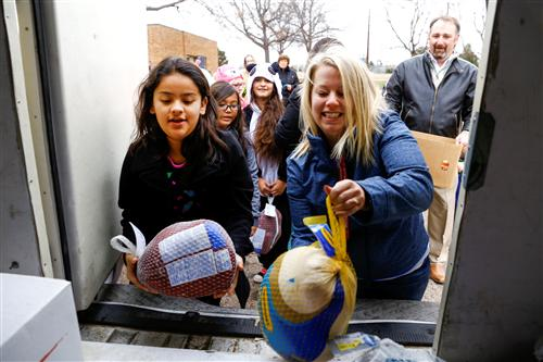 Student Council members with frozen turkeys