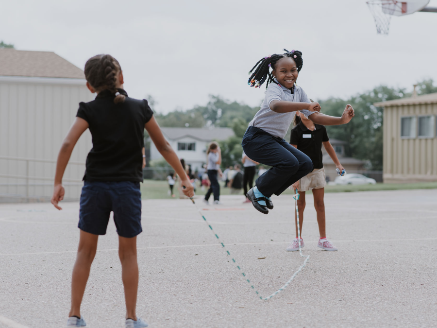 Centennial Elementary student playing with jump rope