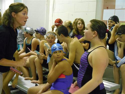 Coach Sands talking to swimmer