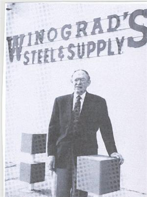 "Our school's namesake, Harold S. Winograd, standing in front of the company he founded, ""Winograd's Steel and Supply""."
